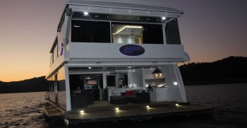 The Houseboat Factory 007 Entertainment Area – Rear View at night (1)